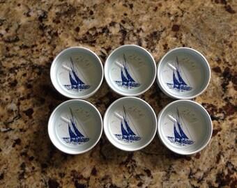 1960s nautical barware coasters, white enamel screened with blue sailboats. White with blue sailboats. Set of 6.