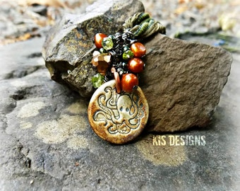 Adjustable Length Necklace featuring Handcrafted Ceramic Octopus Pendant, Freshwater Pearl and Peridot on Hand Dyed Silk Ribbon