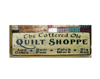 The tattered ole quilt shoppe primitive wood sign