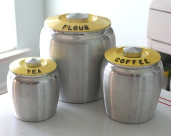 Set of Kromex Yellow Canisters