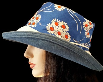 Sunblocker - Big brim sun hat with blue, orangy red and white daisy print with adjustable fit
