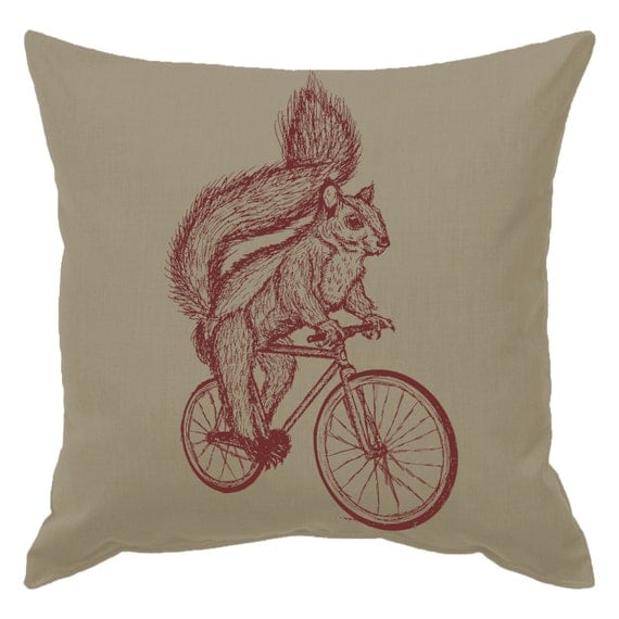 squirrel on a bicycle throw pillow