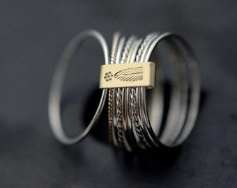 9 twist and turn silver with 14kt yellow gold stacking rings