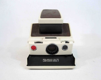 Vintage Polaroid SX-70 Folding Land Camera Model 2 in White. Non-Working. For Parts or Display. Circa 1970's.