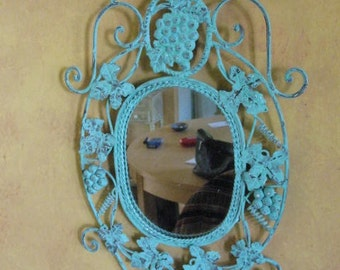 Large mirror with verdigris metal frame 21 inches tall