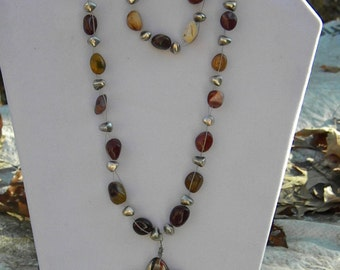 REDUCED* Multi browns with star pendant