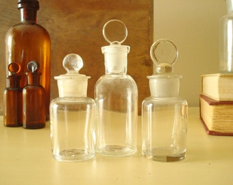 Antique apothecary jars, clear tab-top bottles, ground glass stopper, authentic 1900s pharmacy bottles, scientific industrial collectibles
