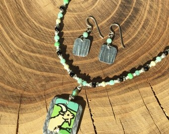 Recycled goat cheese can layered with recycled aluminum frozen pie tin earrings and necklace