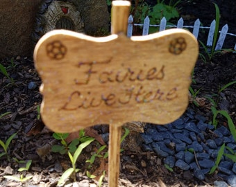 """Handmade wooden fairy garden sign """"Fairies Live Here"""" with calligraphy burned letters"""