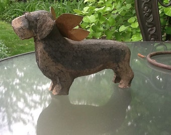 Wirehair dachshund with metal wing and hook   Gray and tan