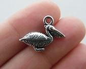 BULK 20 Pelican charms antique silver tone B149