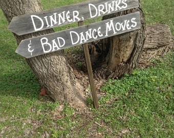 Fun Wedding Reception Double Wood Board Sign on Stake Directional Arrow Dinner Drinks and Bad Dance Moves