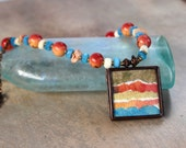 Watercolor Locket Necklace Torn Paper Ocean Sunset Collage with Apple Coral and Blue Czech Glass Brass Picture Locket Boho Beach Jewelry