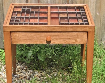 Cherry wood end table or bedside table with a drawer and a top made from a printer's type tray with colorful wood inlays.