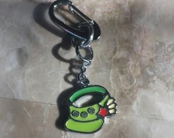 Green visor, crystals , red star, key klip, zipper pull, purse pull, journal, backpack