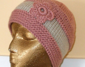 Hand knit hat of cloche in a light dusty pink 100 percent Acrylic