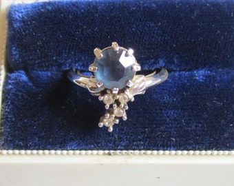 Vintage Avon Silver Tone Ring with Dark Blue Rhinestone and Small Clear Rhinestones