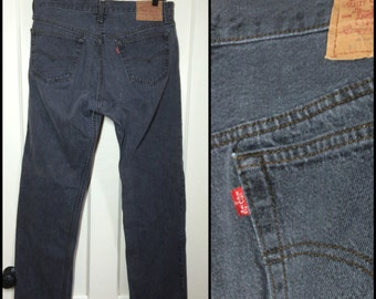 Vintage Levi's faded Black 501 button fly jeans, label reads 34X32, measures 33x31 Straight Leg black denim made in USA Boyfriend jeans #124