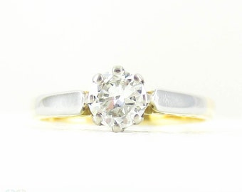 Vintage Diamond Solitaire Engagement Ring. Classic Transitional Cut Diamond Single Stone Set in 18 Carat Gold. 0.27 ctw, Circa 1940s.