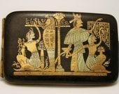 Vintage black and gold Damascene cigarette case. Egyptian revival
