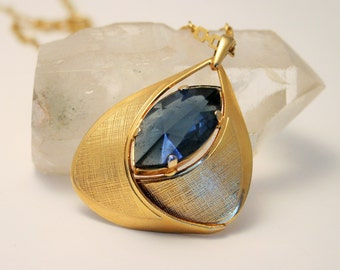 Vintage blue glass pendant on a chain.  1960s necklace