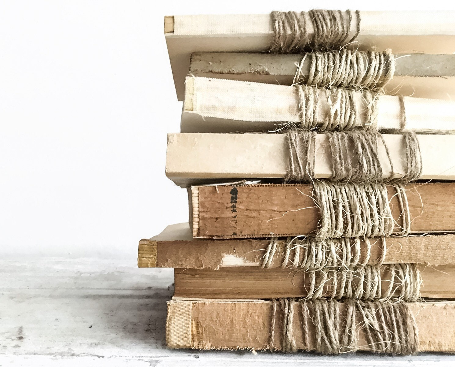 set of 3 unbound vintage books wrapped in twine farmhouse