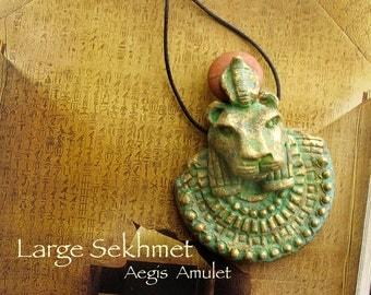 Sekhmet Aegis Amulet Large -  Lioness Goddess She Who Is Powerful - Handcrafted Clay Pendant with Red Marble Solar Disc - Aged Brass Patina