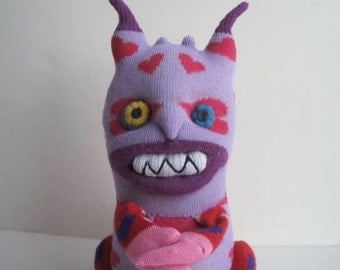 YENTE,  a monster sock toy, cute as the devil, a professional match maker and all heart.