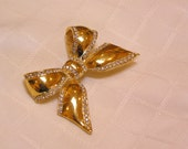Kenneth J Lane KJL gold tone bow with rhinestone trip ribbons pendant brooch