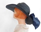 Vintage blue hat, wide brim tilt by Mr. John, wide bow, sculpted crown
