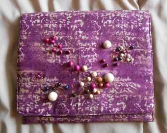 purple and tan batik clutch
