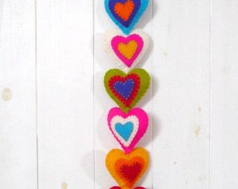 Colorful felt hearts wall hanging - 9 stuffed hearts