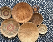 vintage set of 7 wall wicker rattan basket / coiled / trivets