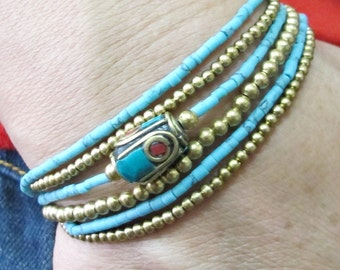 Multi Strand Turquoise Stick and Drum Tibetan Style Brass with Coral and Turquoise Bracelet in Brass Bead.