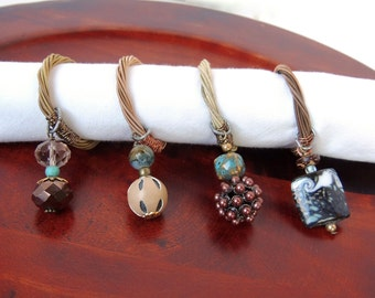 BEADED NAPKIN RINGS -  Guitar String Napkin Rings - set of 4 - gold, bronze, turquoise -  upcycled/recycled - gifts under 25 dollars