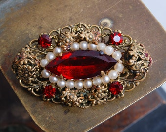 Vintage filigree brooch, with red glass rhinestones