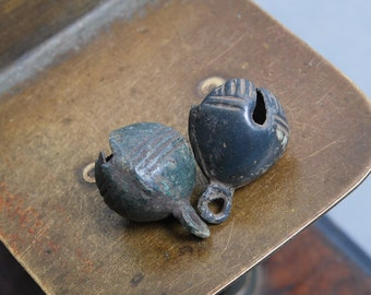 Pair of antique brass jingle bells. Black patina of time. Ringing