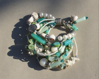 Handmade multi strand bracelet in turqoise and white by Flamejewels