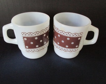 A Pair of Fire King Brown Polka Dot and Lace Stackable Coffee Mugs