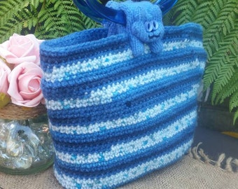 Blue and Turquoise Crocheted Sausage Cats handbag, with knitted Cats handles