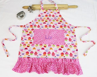 Personalized and Ruffled Gourmet Pink Cupcakes Child Apron with polka dot pocket and ruffle - made to order