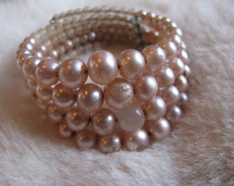 1950s FABULOUS four inch strand memory wire cuff bracelet of patina milk glass pearls