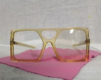 Unique frame made by Sir Winston Eyewear yellow clear color s.w.i. 56/20  5 1/2 temple size.