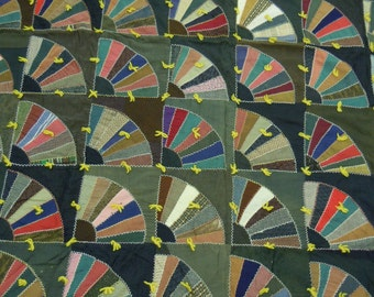 Quilt/comforter:  Grandmother's fan 1920's embroidered  with gold back fabric and wool fans