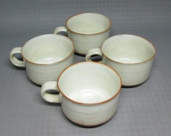 Kiln Craft 4 cups and saucers , red terra cotta clay , on the mark  is K.K.1