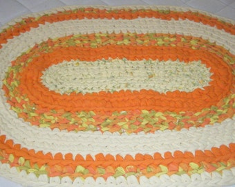 Yellow and Orange Oval Rug