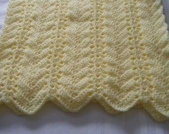 Yellow crocheted rippled baby blanket