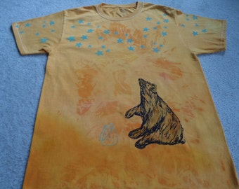 Glow in the dark stars, bear is catching fire flies, man's small printed and dyed t-shirt, thermofax screens, low immersion dyeing