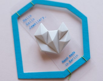 White minimalist geometric triangle brooch