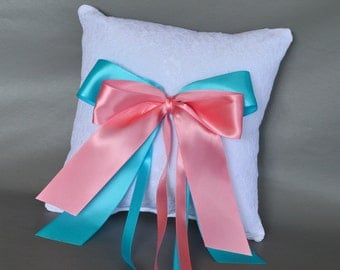 Lace wedding ring pillow with light turquoise and coral ribbons